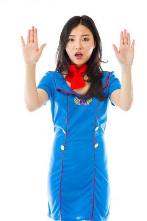 stop gesture: Asian air stewardess making stop gesture and showing stop