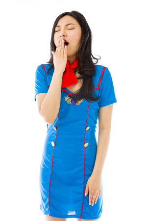 Asian air stewardess yawning with hand over mouth
