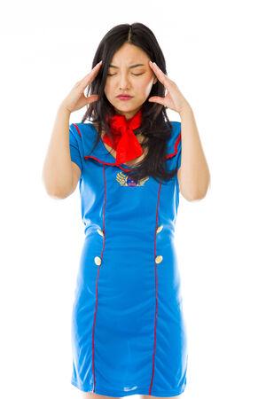 Asian air stewardess suffering from headache