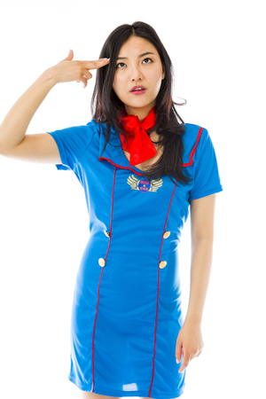 Asian air stewardess pointing finger to head Stock Photo