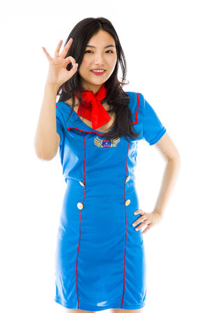 Asian air stewardess showing ok sign isolated on white background Stock Photo