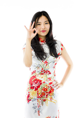 Asian young woman showing ok sign isolated on white background photo