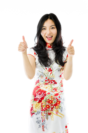 Asian young woman showing thumbs up from both hands isolated on white background photo