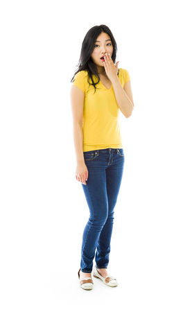 raised eyebrows: Young Asian woman with shocked expression isolated over white background