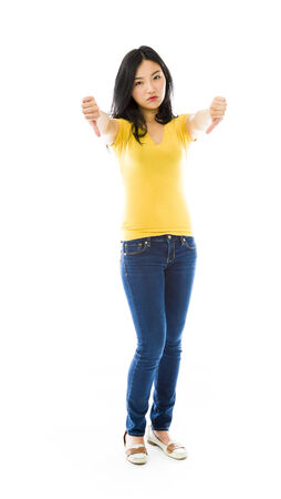 Young Asian woman showing thumbs down sign from both hands photo