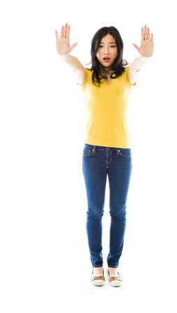 outstretched: Young Asian woman making stop gesture sign from both hands