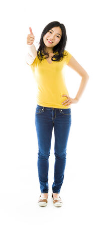 blue jeans: Young Asian woman showing thumb up sign and smiling