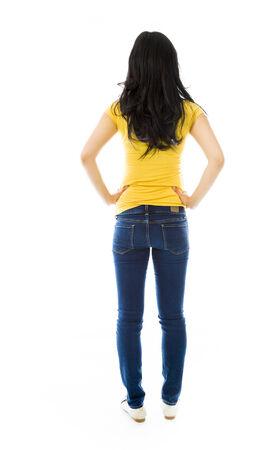 mani sui fianchi: Vista posteriore di una giovane donna asiatica in piedi con le braccia sui fianchi Archivio Fotografico