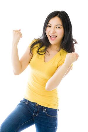 Young Asian woman celebrating success Stock Photo