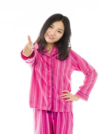 Young Asian woman showing thumb up sign and smiling photo