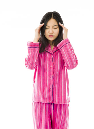 Young Asian woman suffering from headache Stock Photo