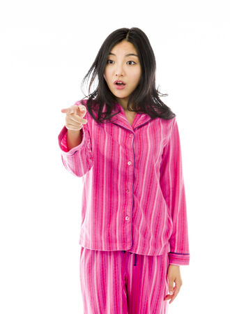 raised eyebrows: Young Asian woman pointing and looking shocked