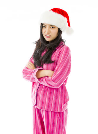 celebratory event: Asian young woman wearing Santa hat and looking angry Stock Photo