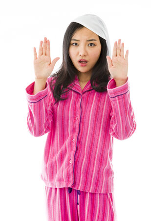 stop gesture: Young Asian woman making stop gesture sign from both hands