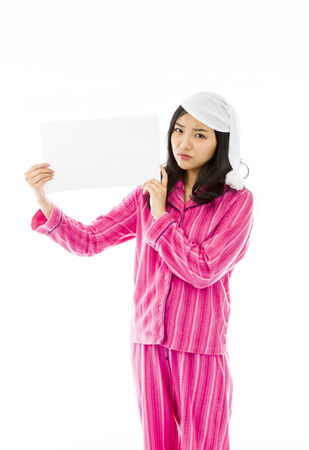 Sad Asian young woman holding a blank placard