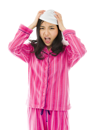 Young Asian woman pulling her hair and screaming in frustration