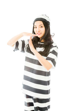 Young Asian woman making time out signal with hands in prisoners uniform