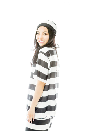 Side profile of an Asian young woman smiling in prisoners uniform