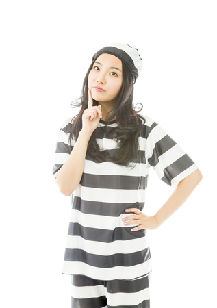 Young Asian woman with finger on chin in prisoners uniform photo