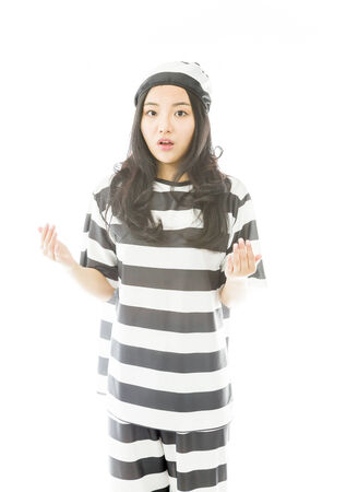 disbelieve: Young Asian woman looking shocked in prisoners uniform Stock Photo