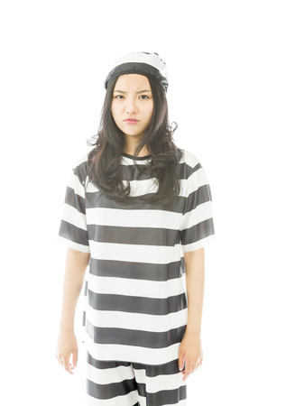 allegation: Portrait of a serious young Asian woman in prisoners uniform Stock Photo