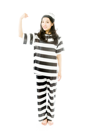 Young Asian woman showing off her muscle in prisoners uniform