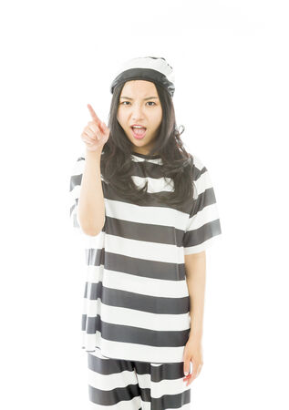 Upset young Asian woman scolding somebody in prisoners uniform photo
