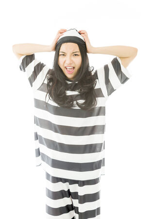 Young Asian woman screaming in prisoners uniform photo