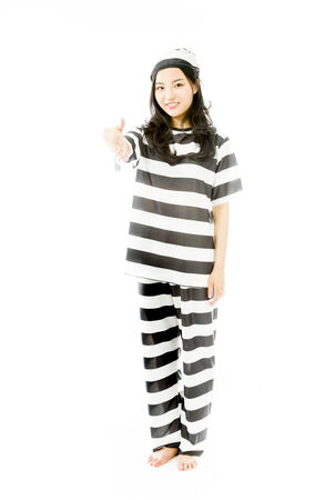Young Asian woman offering hand for handshake in prisoners uniform photo
