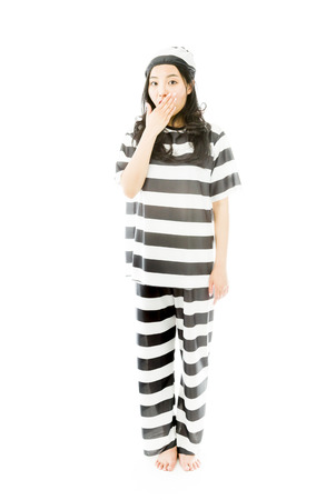 Young Asian woman with shocked expression in prisoner uniform photo