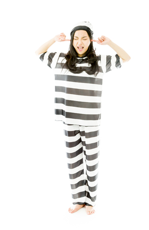Young Asian woman shouting in frustration in prisoners uniform photo