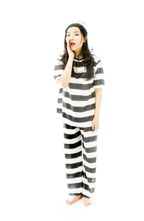 Young Asian woman whispering in prisoners uniform photo