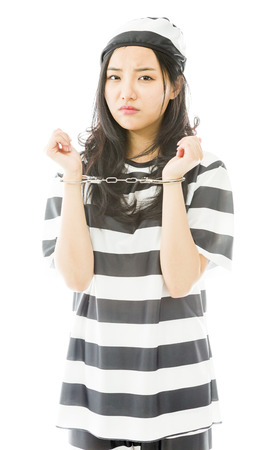 handcuffed: Sad handcuffed Asian young woman in prisoners uniform