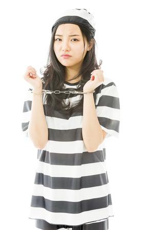 arrest women: Sad handcuffed Asian young woman in prisoners uniform