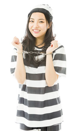 handcuffed: Handcuffed Asian young woman in prisoners uniform Stock Photo