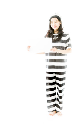 Asian young woman holding a blank placard prisoners uniform photo