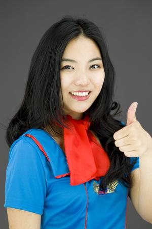 Asian air stewardess making thumbs up sign photo