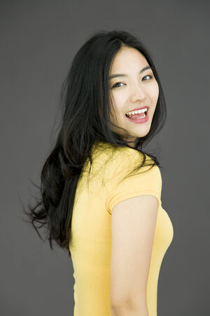 Side profile of an Asian young woman smiling