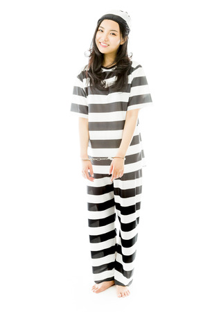 Handcuffed Asian young woman in prisoners uniform Banco de Imagens