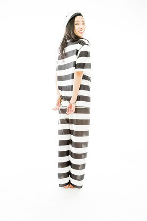 woman prison: Handcuffed Asian young woman in prisoners uniform Stock Photo
