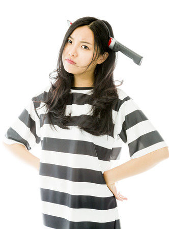 Asian young woman wearing knife shaped hair band in prisoners uniform photo