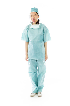 Asian female surgeon shouting 免版税图像