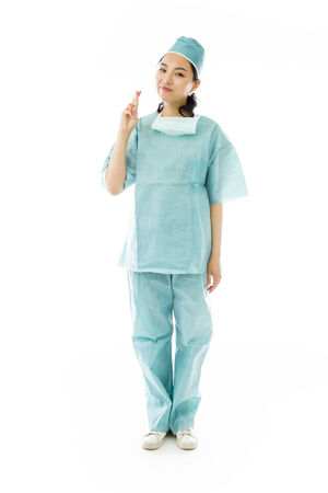 Asian female surgeon crossing her fingers photo