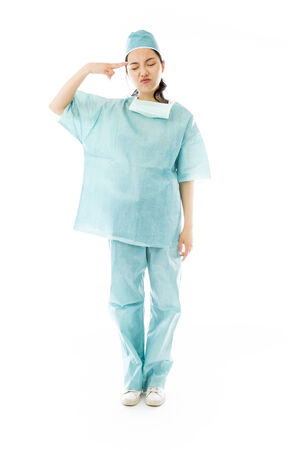 Asian female surgeon pointing finger to head photo