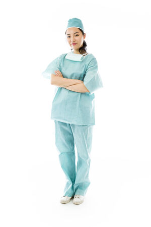 Confident Asian female surgeon standing with arms crossed photo