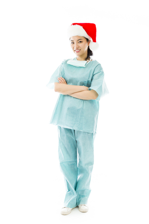 celebratory event: Asian female surgeon wearing Santa hat