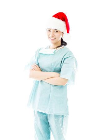 wearing santa hat: Asian female surgeon wearing Santa hat