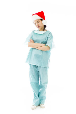 celebratory event: Upset Asian female surgeon wearing Santa hat