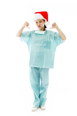 celebratory event: Unhappy Asian female surgeon giving thumbs down gesture Stock Photo
