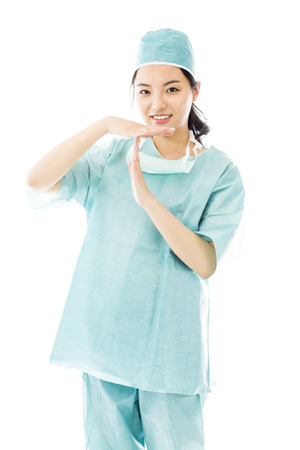 Asian female surgeon showing timeout signal Фото со стока